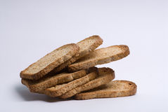 Slices of brown bread. Side view of slices of brown bread isolated on white studio background Stock Photography