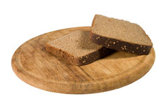Slices of brown bread on a plate Royalty Free Stock Photography