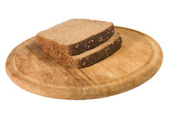 Slices of brown bread on a plate Royalty Free Stock Photos