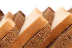 Slices of brown and white bread. Stock Images