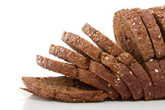 Slices of brown whole grain bread Stock Photos