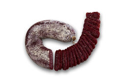 Slices of Bulgarian flat dry salami - sudzhuk. Slices of Bulgarian sudzhuk isolated on white background. Clipping path included Royalty Free Stock Images