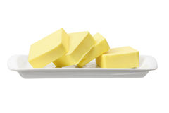 Slices of Butter. On White Background Royalty Free Stock Photos