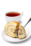 Slices of cake and cup of tea Stock Images