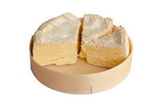 Slices of  Camembert cheese in box, isolated. French cheese : slices of  Camembert in the wood box, isolated on white Royalty Free Stock Images