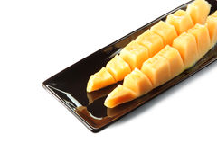 Slices cantaloupe melon fruit in blackdish. Stock Images