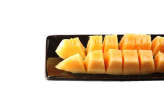 Slices cantaloupe melon fruit in blackdish. Royalty Free Stock Image