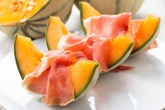 Slices of cantaloupe melon with ham Stock Images