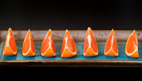 Slices of  the cara cara oranges with its pinkish red color inte Royalty Free Stock Photo