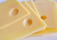 Slices of cheese. Slices of cheese over white, background Royalty Free Stock Photos