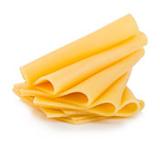 Slices of cheese close-up isolated on a white background. Royalty Free Stock Photo