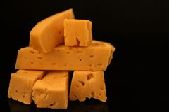 Slice of cheese. Slices of cheese on a dark background royalty free stock photo