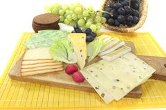 Slices of cheese with grapes Royalty Free Stock Photo