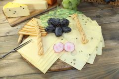 Slices of cheese with grapes Stock Image