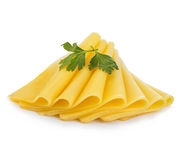 Slices of cheese with parsley close-up isolated on a white background. Stock Photography