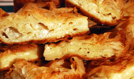 Slices of cheese pie. Pieces of flaky cheese pie close up Stock Photos
