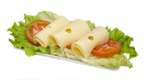 Slices of cheese on salad Royalty Free Stock Photos