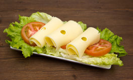 Slices of cheese on salad on wood Royalty Free Stock Photography