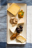 Slices of Cheese with Shallots and Vegetables in Rectangular Dish Stock Photos