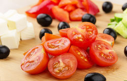 Slices of cheese, tomatoes, peppers, cucumbers and black olives Stock Images