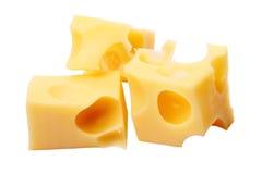 Slices of cheese on white stock photos