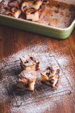 Slices of cherry cake on a cooling hatch with cake in a pan in a background. Stock Photography