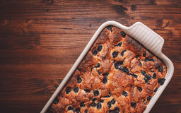 Slices of cherry cake on a cooling hatch with cake in a pan in a background. Cherry cake in a baking pan on a wooden background. Top view Royalty Free Stock Photography