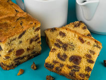 Slices of Cherry Fruit Cake With Tea or Coffee. Against a Blue Background Stock Photos