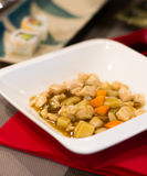 Slices of chicken with bamboo and carrots in a sweet sauce Stock Images