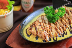 Slices of chicken with black sweet sauce and cheese. Stock Image
