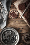 Slices of chocolate brownie with blueberry and vintage dinnerware  vertical Stock Photography