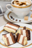 Slices of chocolate cake and coffee with cream Stock Photo