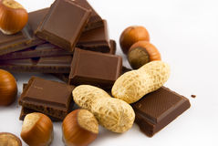 Slices of chocolate and nuts stock photography
