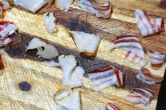 Slices of cold cuts on a wooden chopping board royalty free stock photo