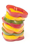 Slices of coloured  Peppers in a stack Royalty Free Stock Image