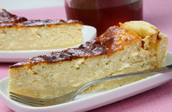 Slices of cottage cheese pie. On plate and cup of tea Stock Image