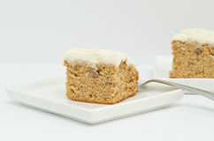 Slices of Cream Cheese Frosted Banana Cake Royalty Free Stock Image