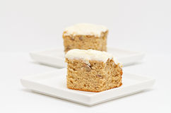 Slices of Cream Cheese Frosted Banana Cake Stock Image