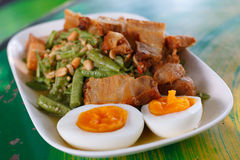 Slices of crispy pork and boiled egg on Yardlong bean salad Stock Photos