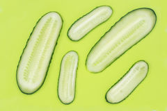 Slices cucumber of on green plastic cutting board Royalty Free Stock Photography