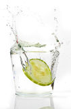 Slices Cucumber splashing into water Stock Images