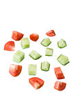 Slices of a cucumber and tomato. On white background Royalty Free Stock Photography