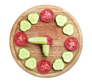 Slices cucumber and tomato in the shape of clock Royalty Free Stock Image