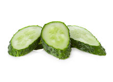 Slices cucumber on white Stock Images