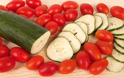Slices of cucumbers and tomatoes . Stock Photos