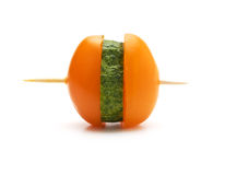 Slices of cucumbers and tomatoes on a wooden stick Stock Image