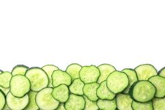Slices of cucumbers on white background. Top view Royalty Free Stock Photos