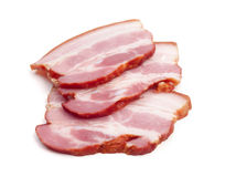 Slices of cured bacon. Cut out on white Royalty Free Stock Image