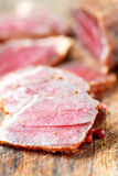 Slices of cured meet and pepper on table close up Royalty Free Stock Photography