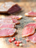 Slices of cured meet and pepper vertical Royalty Free Stock Images